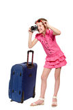 Girl with suitcase and old style photo camera Royalty Free Stock Image