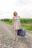 Girl with a suitcase Royalty Free Stock Photo