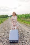 Girl with a suitcase Stock Photos