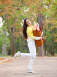 Girl with suitcase in the park. Royalty Free Stock Photography
