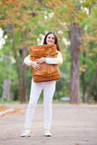 Girl with suitcase in the park. Royalty Free Stock Images