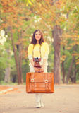 Girl with suitcase in the park. Royalty Free Stock Photo