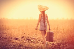 Girl with suitcase Stock Image