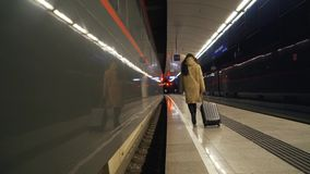 Girl with a suitcase on the platform.  stock video