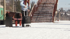 Girl with suitcase. Through railway passes Girl with suitcase stock footage