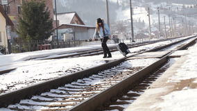 Girl with suitcase stock video footage