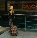 Girl with a suitcase at the railway station Stock Photography