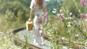 Girl with a suitcase on the railway tracks. stock footage