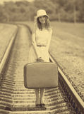 Girl with suitcase at railways. Royalty Free Stock Image