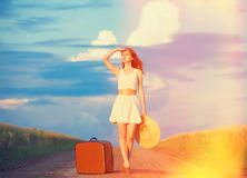 Girl with suitcase Stock Images