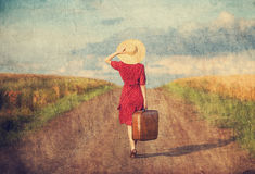 Girl with suitcase Royalty Free Stock Image
