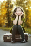Girl on suitcase Royalty Free Stock Images