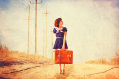 Girl with suitcase on the road Royalty Free Stock Photography