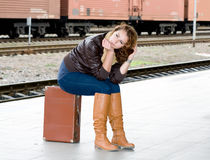 Girl is suitcase waiting for the train Royalty Free Stock Images