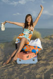 Girl with suitcases Royalty Free Stock Photography
