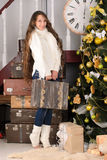 Girl with suitcases in christmas interior Stock Photography