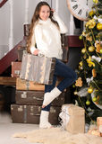 Girl with suitcases in christmas interior Royalty Free Stock Photography