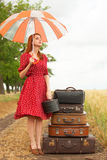 Girl with suitcases Stock Image