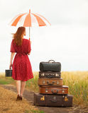 Girl with suitcases Royalty Free Stock Image