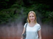 Girl in sulfur Spring. A blonde girl in Sulfur Spring in Japan Royalty Free Stock Image