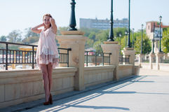 Girl in the summer beige dress Royalty Free Stock Photography