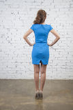 Girl in summer blue dress. back view Stock Photos