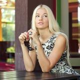Girl in summer cafe Stock Photos