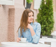 Girl in summer cafe Stock Images