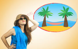 Girl with summer clothes dreaming of an exotic island with hammo Stock Photos