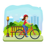 Girl in summer clothes, riding a bike for leisure park. Woman in summer clothes, riding a bike for leisure park, on the background of the city and its streets Royalty Free Stock Photo