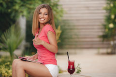 Girl with summer cocktail outdoor. Royalty Free Stock Image