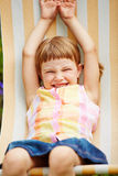 Girl in summer in a deck chair Royalty Free Stock Photography