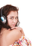 Girl in summer dress listen music. Stock Images
