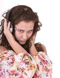 Girl in summer dress listen music. Royalty Free Stock Image