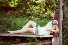 Girl in a summer dress lying and relaxing Stock Images