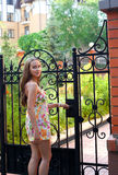 Girl in summer dress - welcome to my house Royalty Free Stock Images