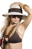 Girl summer drink. Blond girl with summer hat and sunglasses taking a glass ith a red drink stock photos
