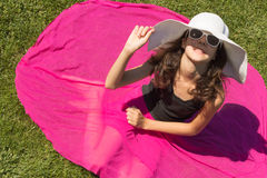 Girl in summer fashion. Young girl in white hat and sunglasses outdoor Royalty Free Stock Photos