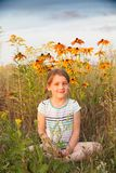 Girl in   summer field. Little five year old girl in   summer field with flowers royalty free stock photo