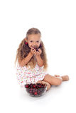 Girl with summer fruits - cherries in a bowl Royalty Free Stock Photo