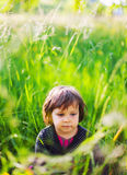Girl in summer garden Stock Image