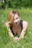 Girl in summer grass Stock Photos