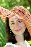 Girl in summer hat Stock Photography