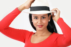 Girl in summer hat Stock Images