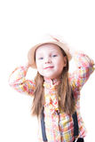 Girl in a summer hat plaid blouse and trousers with suspenders Royalty Free Stock Images