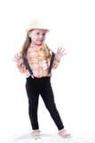 Girl in a summer hat plaid blouse and trousers with suspenders Royalty Free Stock Image