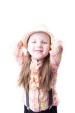 Girl in a summer hat plaid blouse and trousers with suspenders Stock Photo