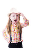 Girl in a summer hat plaid blouse and trousers with suspenders Royalty Free Stock Photos