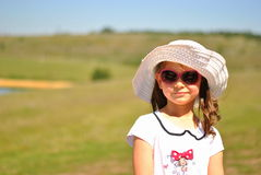 Girl in summer hat and sunglasses. Smiling girl in summer hat and sunglasses Stock Photography