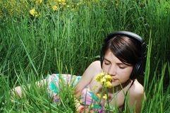Girl in summer meadow Stock Image